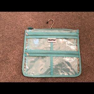 RuMe multi-zipper travel bag